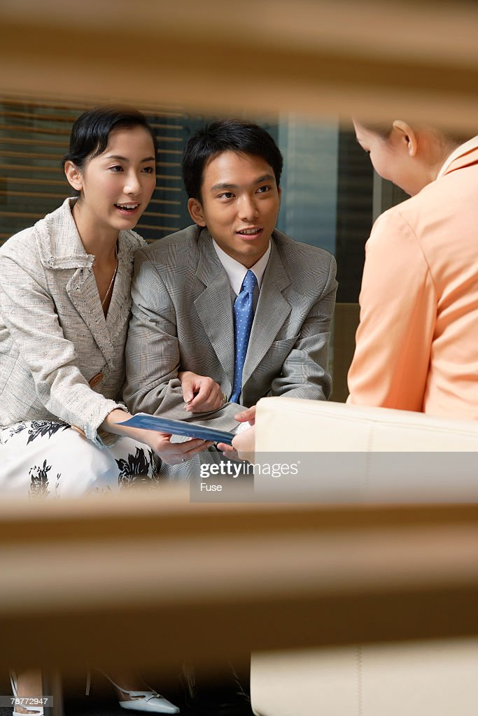 Young Couple Meeting with Financial Planner