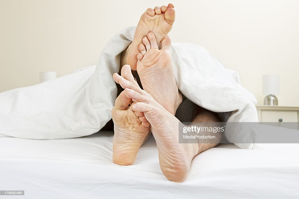 Young couple messing in bed : Stock Photo