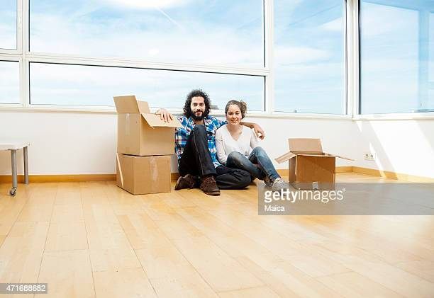 Young couple moving house happy