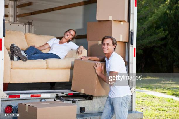 Young couple moving house, taking a break