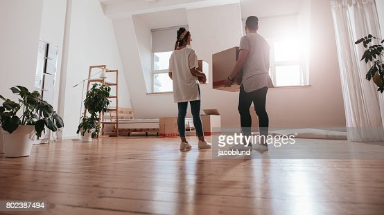 Young couple moving in new house : Stock Photo