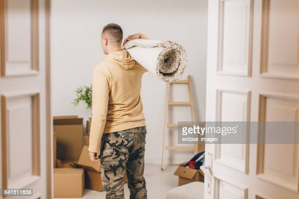 Young couple moving in to new house