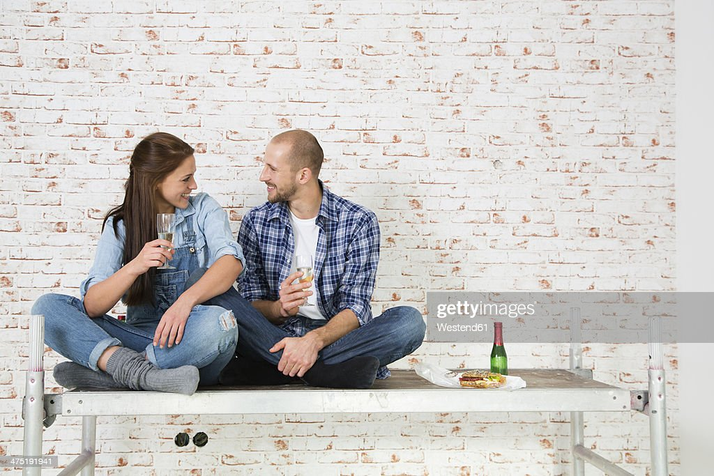 Young couple moving into new home drinking champagne stock photo getty images - Young couple modern homes ...