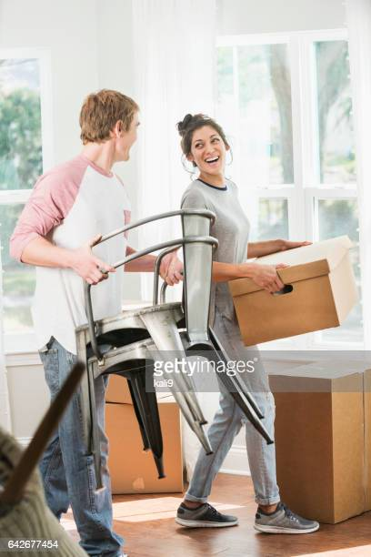 Young couple moving into new home or apartment