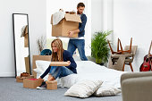 Young couple moving into their new house