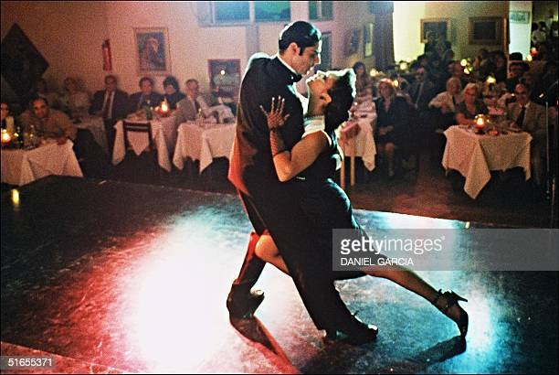 A young couple of professional tango dancers perform 03 April 1993 in the 'Galeria del Tango Argentino' one of the Buenos Aires famous barrestaurants...