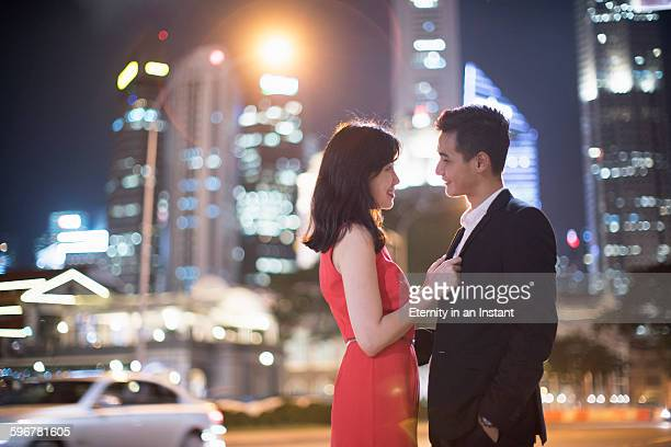 Young couple on a date in the city at night.