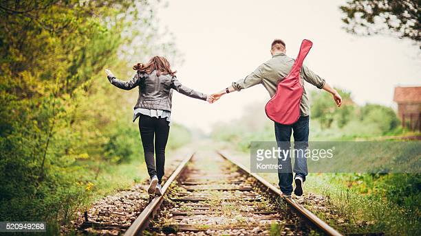 Young couple on a railway tracks