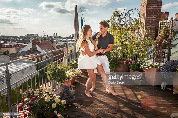 Young Couple On Balcony, Dancing, Munich, Bavaria, Germany, Europe