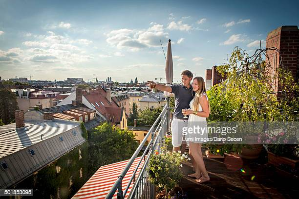 Young Couple On Balcony, Munich, Bavaria, Germany, Europe