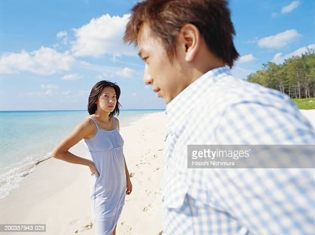 Young couple on beach (focus on woman)