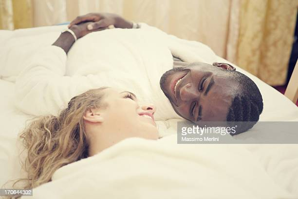 Young couple on bed