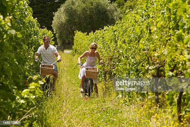 Young couple on bikes in the Ata Rangi vineyards