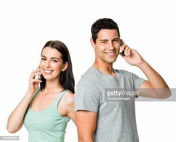 Young Couple on Cellphones - Isolated