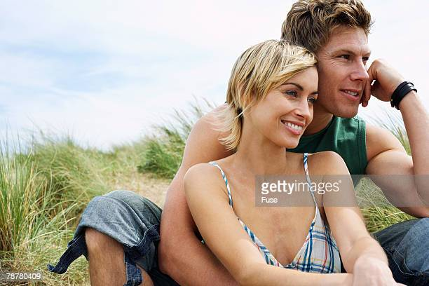 Young Couple on Dunes at Beach