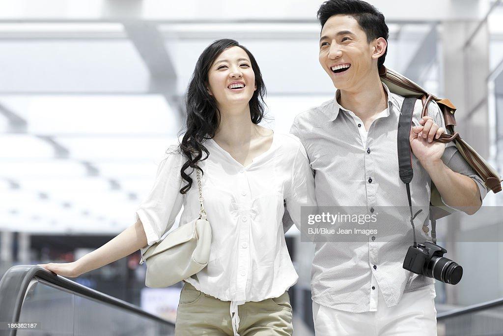 Young couple on escalator