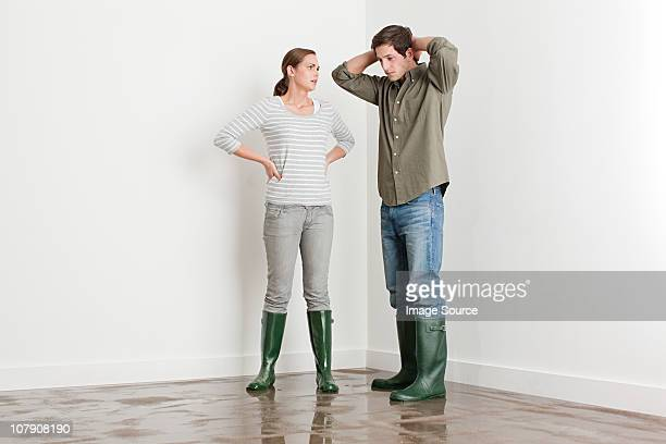 Young couple on flooded floor