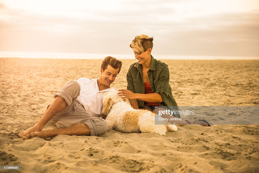 Young couple on Mission Beach with dog, San Diego, California, USA : Stock Photo