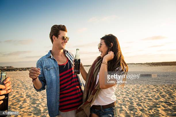 Young couple on Mission Beach, woman holding cola, San Diego, California, USA