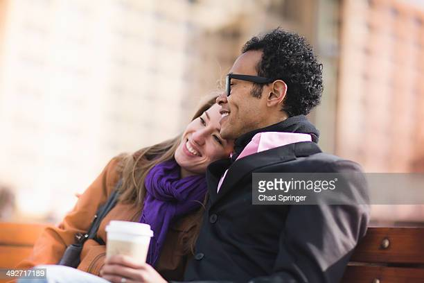 Young couple on park bench, New York, USA
