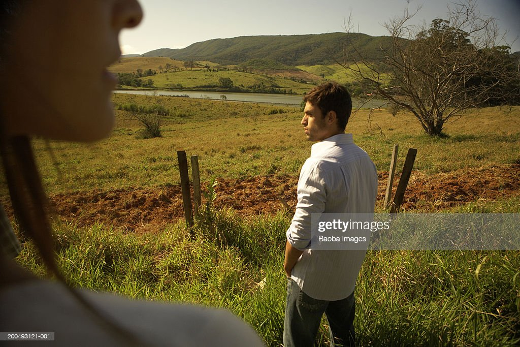 Young couple on ranch (focus on man) : Stock Photo