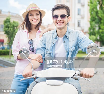 Young couple on scooter : Stock Photo