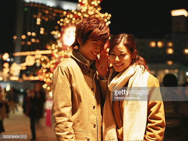 Young couple on street, smiling