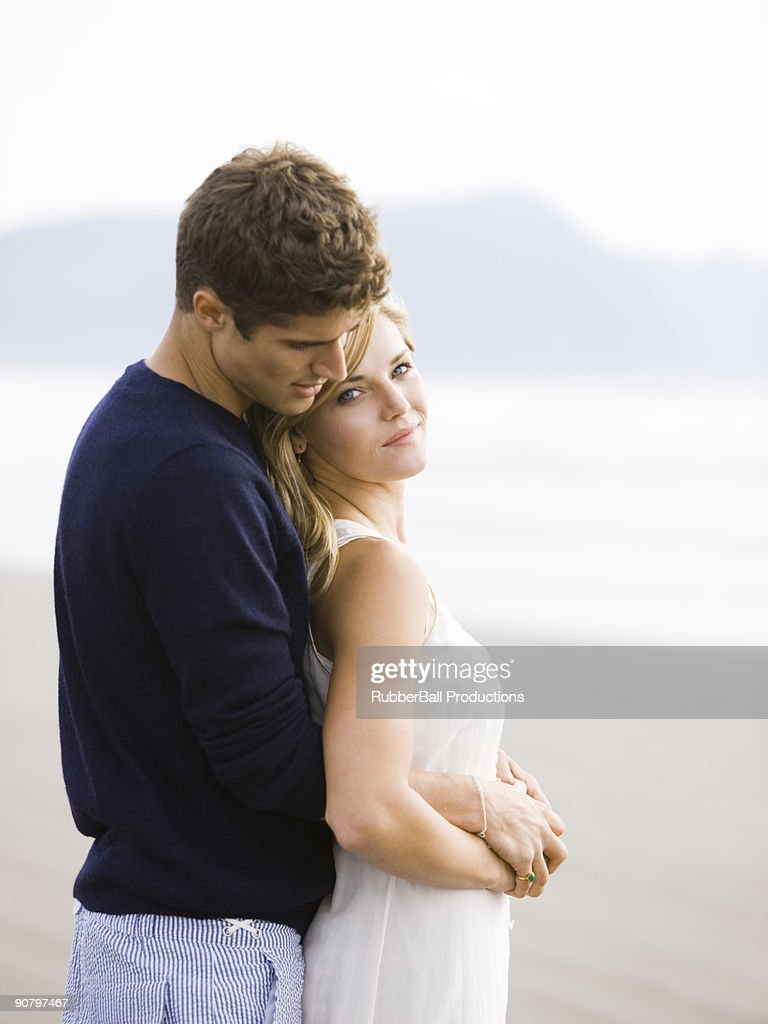 young couple on the beach : Stock Photo