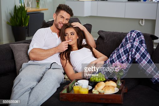 Young couple on the sofa : Stock Photo