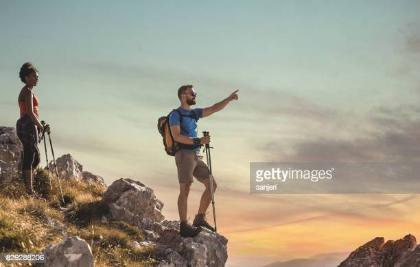 Young Couple on Top of Mountain