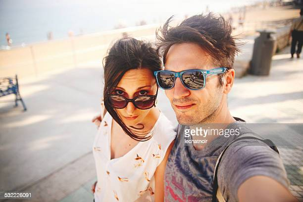 young couple on vacation taking a self portrait