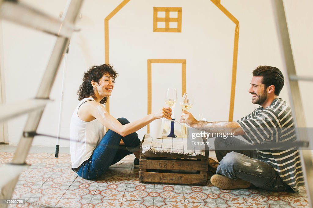 Young couple painting their new apartment.