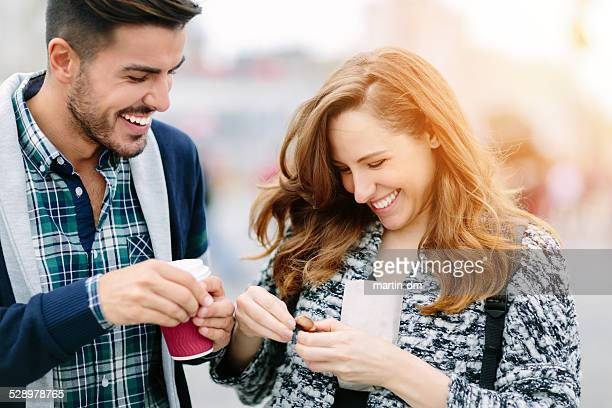 Young couple peeling chestnuts