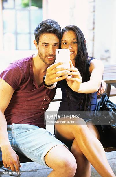 Young couple photographed while taking a selfie