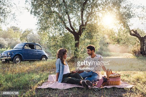 Young Couple Picnic At Sunset