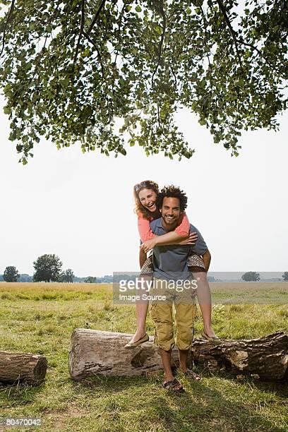 Young couple piggybacking