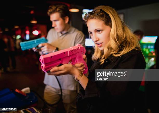 Young Couple Playing Arcade Games