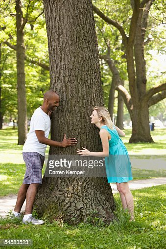 Young couple playing around in a park : Stock Photo