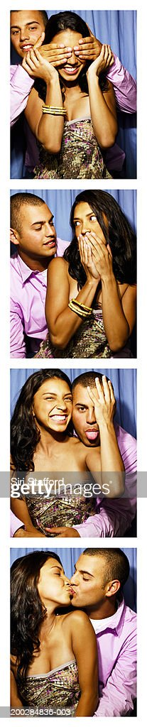 Young couple playing around in photo booth : Stock Photo