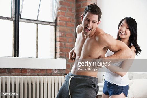 Young couple playing around : Stock Photo