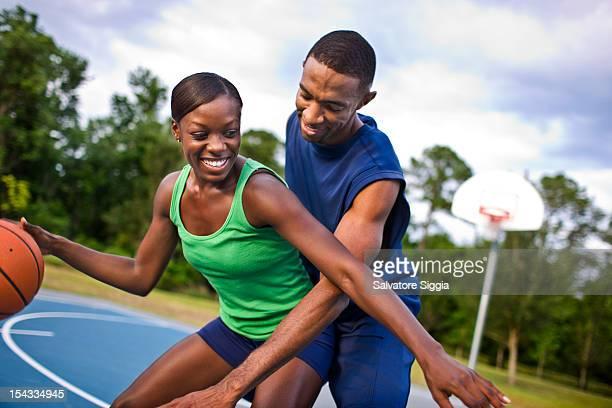 Young couple playing basketball