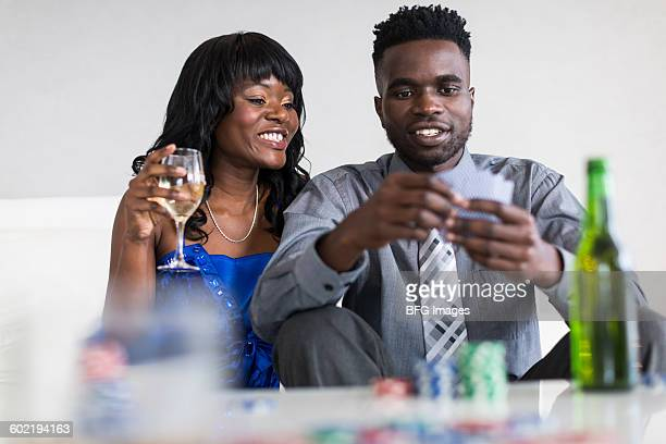 Young couple playing cards, Cape Town, South Africa