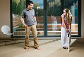 Young couple playing cricket in living room