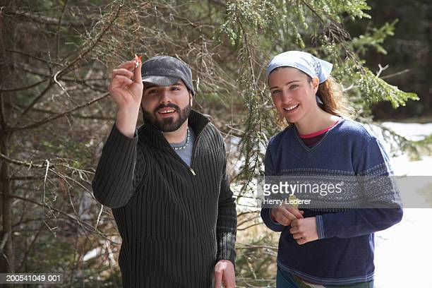 Young couple playing darts, man aiming dart