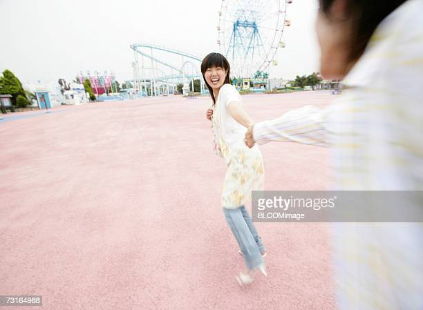 Young couple playing in the amusement park