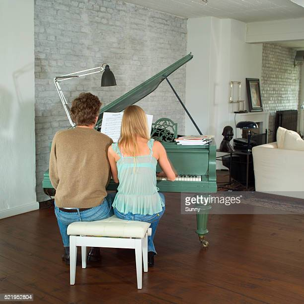 Young Couple Playing Piano
