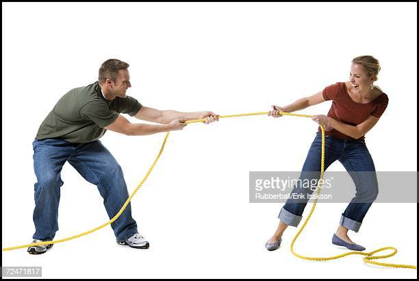 Young couple playing tug-of-war