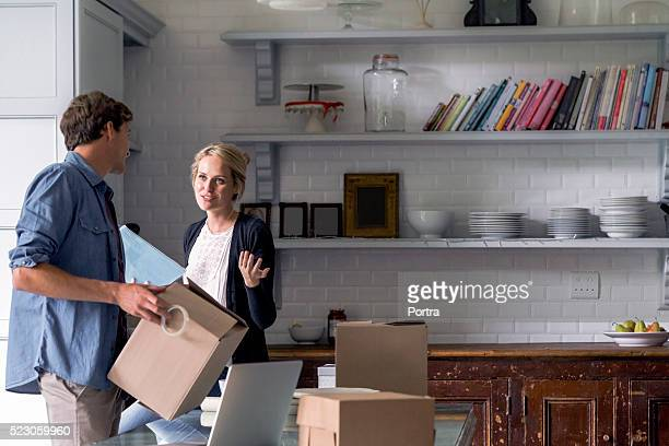 Young couple preparing gifts for Christmas at home