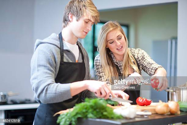 Young couple preparing meal