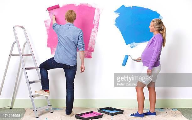 Young couple preparing nursery